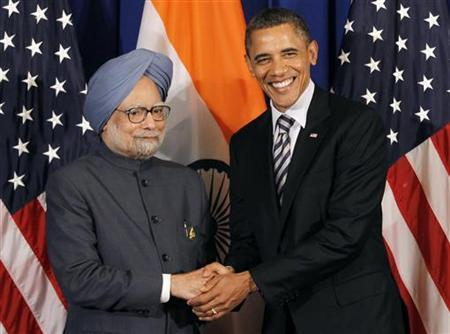 U.S. President Barack Obama shakes with Indian Prime Minister Manmohan Singh on the sidelines of the ASEAN Summit in Nusa Dua, Bali, November 18, 2011. REUTERS/Jason Reed