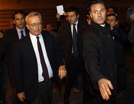 Former Italian Finance Minister Giulio Tremonti (L) leaves after the vote for package of economic reforms intended to reverse a collapse of market confidence at the lower house of the Parliament in Rome November 12, 2011. REUTERS/Tony Gentile