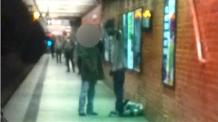 Two men are seen talking on a New York City subway platform in this framegrab from a video released by the New York City Police Department December 3, 2012. According to police, the man on the right pushed the other man (face blocked), 58-year-old Han Ki-Suck, onto the track as the southbound train on the N-Q-R line was pulling into the station at 49th Street near Times Square. Han was trapped between the platform and the train and was taken to a nearby hospital where he was pronounced dead. The other man who escaped and is still at large, police said. BEST QUALITY AVAILABLE REUTERS/NYPD/Handout