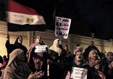 "Supporters of Egypt's President Mohammed Mursi chant slogans while holding a placard reading: ""Yes for the Constitution"", outside the presidential palace in Cairo December 5, 2012. Islamists fought protesters outside the Egyptian president's palace on Wednesday, while inside the building his deputy proposed a way to end a crisis over a draft constitution that has split the most populous Arab nation. REUTERS/Mohamed Abd El Ghany"