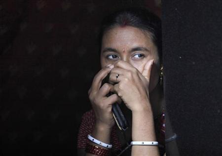 A sex worker watches a Raksha Bandhan festival celebration in a red light area in Mumbai August 23, 2010. REUTERS/Danish Siddiqui
