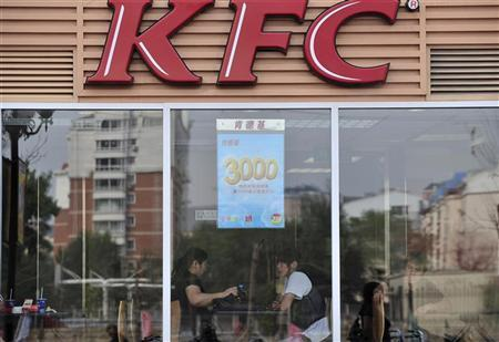 People dine at a Kentucky Fried Chicken (KFC) outlet in Shenyang, Liaoning province June 2, 2010. REUTERS/Stringer