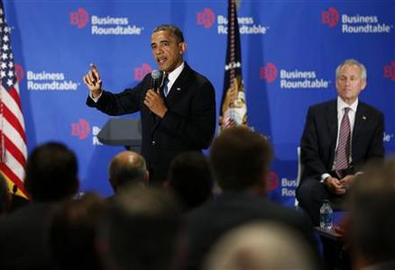 U.S. President Barack Obama speaks at the Business Roundtable while Boeing Chief Executive Officer James McNerney (R) listens, in Washington December 5, 2012. REUTERS/Larry Downing