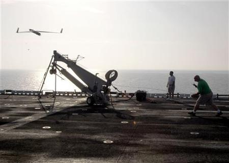 The ScanEagle Unmanned Aerial Vehicle (UAV) launches from the flight deck of the amphibious assault ship USS Saipan in the Persian Gulf in this October 28, 2006 handout photo obtained by Reuters December 5, 2012. REUTERS/U.S. Navy/Mass Communication Specialist 3rd Class Gary L. Johnson III/Handout