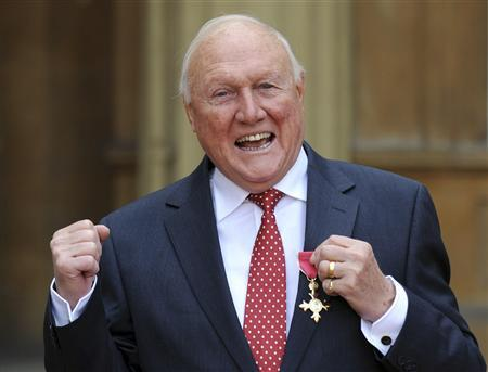 BBC broadcaster Stuart Hall poses after being made an Officer of the British Empire (OBE) by Britain's Queen Elizabeth at an Investiture ceremony in Buckingham Palace, central London in a March 22, 2012 file photo. REUTERS/Stefan Rousseau/Pool/files