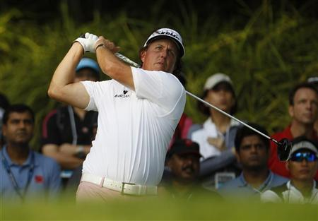 Phil Mickelson of the U.S. tees off on the 12th hole during the first round of the Barclays Singapore Open golf tournament in Sentosa November 8, 2012. REUTERS/Edgar Su