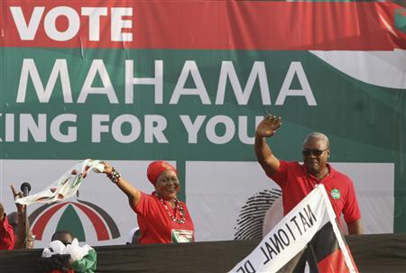 John Dramani Mahama (R), Ghana's interim president and National Democratic Congress (NDC) presidential candidate,waves with his wife Lordina Mahama during his last electoral rally at a trade fair in Accra December 5, 2012. Ghana will hold presidential elections on Friday. NDC is the party of late president John Atta Mills. REUTERS/Luc Gnago