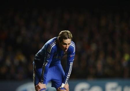 Chelsea's Fernando Torres reacts during their Champions League Group E soccer match against FC Nordsjaelland at Stamford Bridge in London December 5, 2012.EUTERS/Dylan Martinez