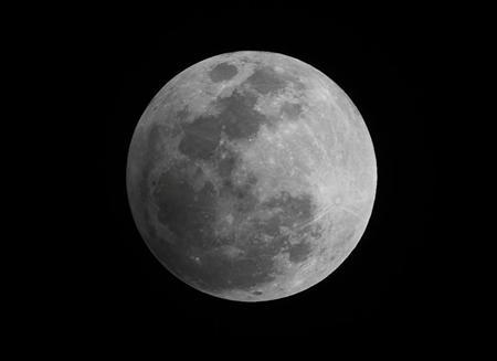 A penumbral eclipse of the moon is seen in the night sky in Manila November 28, 2012. REUTERS/Romeo Ranoco
