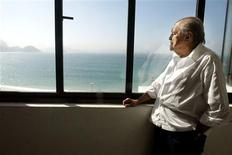 Brazilian architect Oscar Niemeyer looks at the Copacabana beach from his office after his interview with Reuters in Rio de Janeiro, in this June 16, 2003 file photo. Niemeyer, a towering patriarch of modern architecture who shaped the look of contemporary Brazil and whose inventive, curved designs left their mark on cities worldwide, died late on December 5, 2012. He was 104. Niemeyer had been battling kidney and stomach ailments in a Rio de Janeiro hospital since early November. His death was the result of a lung infection developed this week, the hospital said, little more than a week before he would have turned 105. REUTERS/Sergio Moraes/Files