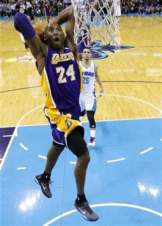 Los Angeles Lakers shooting guard Kobe Bryant (24) goes to the basket during the first half of their NBA basketball game against the New Orleans Hornets in New Orleans, Louisiana December 5, 2012. REUTERS/Jonathan Bachman