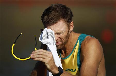 Three-time Olympic gold medal winner Drew Ginn prepares to race as part of Australia's Olympic coxless fours during a training session at the Sydney International Regatta Centre May 10, 2012. REUTERS/Tim Wimborne