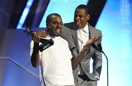 Kanye West and Jay-Z (R) accept the award for best group at the 2012 BET Awards in Los Angeles, July 1, 2012. REUTERS/Phil McCarten/Files
