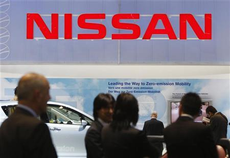 Visitors talk at the Nissan stand during the second media day of the 80th Geneva Auto Show at the Palexpo in Geneva March 3, 2010. REUTERS/Denis Balibouse/Files