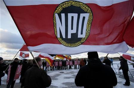 Party members of the far-right National Democratic Party (NPD) attend a protest rally in front of a hotel where German state ministers are holding a conference in Rostock December 5, 2012. Germany is set to take a major step towards banning the far-right National Democratic Party (NPD) on Wednesday when regional politicians formally recommend going ahead with hotly-disputed legal proceedings. REUTERS/Tobias Schwarz (GERMANY - Tags: POLITICS)