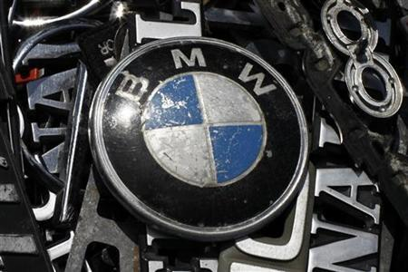 An old BMW emblem is displayed at antique market in Olszyny near Szczytno, northern Poland July 22, 2012. REUTERS/Kacper Pempel (POLAND - Tags: TRANSPORT BUSINESS LOGO)