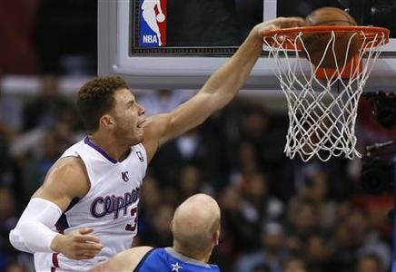 Los Angeles Clippers Blake Griffin (L) slam dunks over Dallas Mavericks Chris Kaman during their NBA basketball game in Los Angeles, California, December 5, 2012. REUTERS/Lucy Nicholson