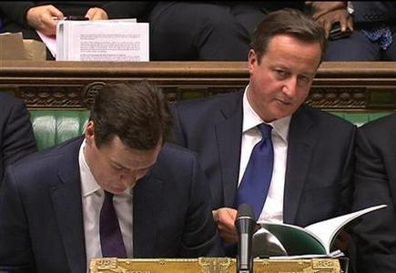 Chancellor of the Exchequer George Osborne (L) and Prime Minister David Cameron listen to the opposition after delivering the autumn budget in parliament in London December 5, 2012. REUTERS/UK Parliament