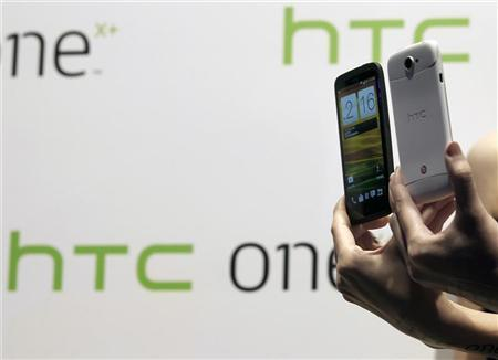 New HTC smartphones, the HTC One X+ (L) and HTC One S Special Edition, are presented during a news conference for the launch of the products in Taipei October 16, 2012. REUTERS/Pichi Chuang