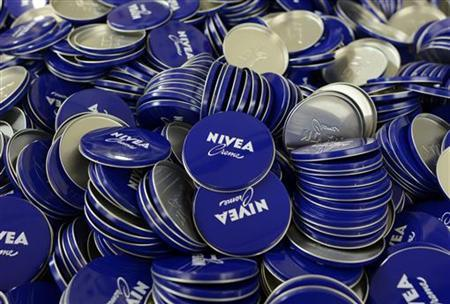 Cover plates of Nivea skin cream are pictured in a production line of German company Beiersdorf AG in Hamburg, April 18, 2012. REUTERS/Fabian Bimmer (GERMANY - Tags: HEALTH)
