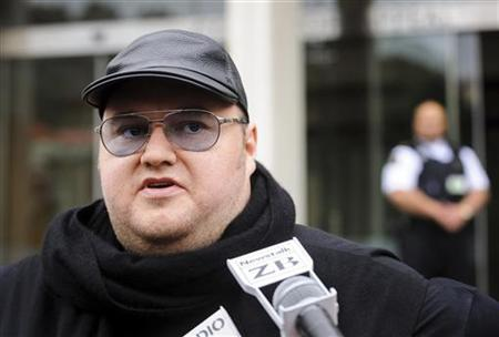 Megaupload founder Kim Dotcom talks to members of the media outside the New Zealand Court of Appeals in Wellington September 20, 2012. REUTERS/Mark Coote/Files