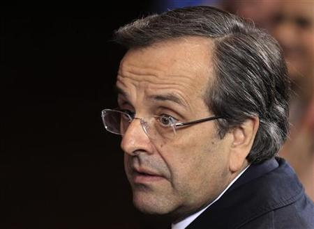 Greece's Prime Minister Antonis Samaras leaves the EU council headquarters after a European Union leaders summit discussing the European Union's long-term budget in Brussels November 23, 2012. EU leaders failed to reach agreement on Friday on a new seven-year budget for their troubled bloc, calling off talks in less than two days after most countries rejected deeper spending cuts demanded by Britain and its allies. REUTERS/Yves Herman (BELGIUM - Tags: POLITICS BUSINESS)