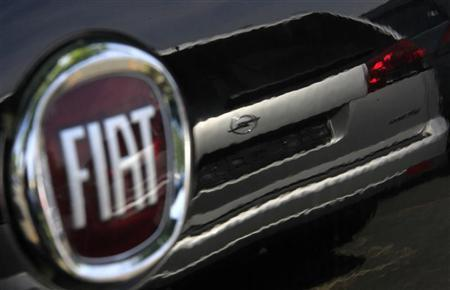 The Fiat logo is seen at a car seller in Darmstadt May 20, 2009. REUTERS/Johannes Eisele/Files
