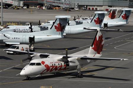 An Air Canada Jazz plane taxis after landing at Pearson International Airport in Toronto April 13, 2012. REUTERS/ Mike Cassese