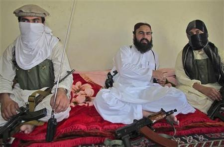 Wali-ur-Rehman (C), deputy Pakistani Taliban leader, who is flanked by militants speaks to a group of reporters in Shawal town, that lies between North and South Waziristan region in the northwest bordering Afghanistan July 28, 2011. REUTERS/Saud Mehsud/Files