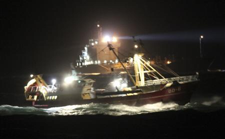 Dutch marine rescue ships are seen during a rescue operation after a collision between the Baltic Ace, a car carrier sailing under a Bahamas flag, and the Corvus J, a container ship from Cyprus, in the North Sea December 5, 2012 in this handout photo released to Reuters by the Dutch Defence Ministry December 6, 2012. The Dutch coastguard said on Thursday it was searching for seven missing crew members of a cargo ship which collided with another vessel and sank in the North Sea the previous evening, killing four people. The coastguard said 13 people have already been rescued, but that the search was being hampered by strong winds and snow which limited visibility. REUTERS/Koninklijke Marine - Ministerie Van Defensie/Handout