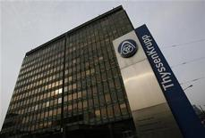 The logo of German industrial conglomerate ThyssenKrupp AG is seen outside the company's headquarter in the western German city of Duisburg May 31, 2012. REUTERS/Wolfgang Rattay (GERMANY - Tags: BUSINESS COMMODITIES LOGO)