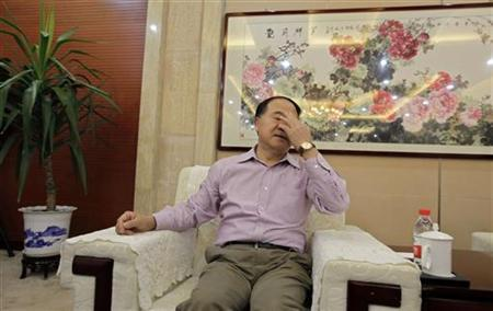 Chinese writer Mo Yan gestures before the start of a news conference in his hometown of Gaomi, Shandong province October 12, 2012. REUTERS/Jason Lee/Files