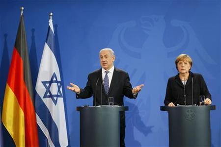 Israeli Prime Minister Benjamin Netanyahu (L) gestures during a news conference with German Chancellor Angela Merkel after bilateral talks at the Chancellery in Berlin December 6, 2012. REUTERS/Wolfgang Rattay