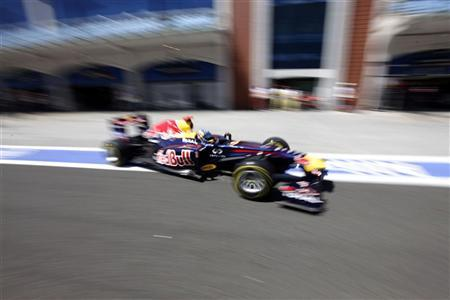 Red Bull Formula One driver Sebastian Vettel of Germany drives after a pit stop in the qualifying session of the Turkish F1 Grand Prix at the Istanbul Park circuit in Istanbul May 7, 2011. REUTERS/Valdrin Xhemaj/Pool