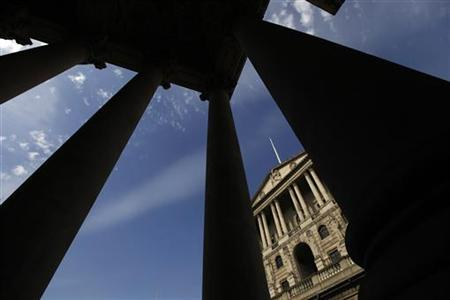 The Bank of England is seen between pillars in the City of London April 11, 2011. REUTERS/Stefan Wermuth
