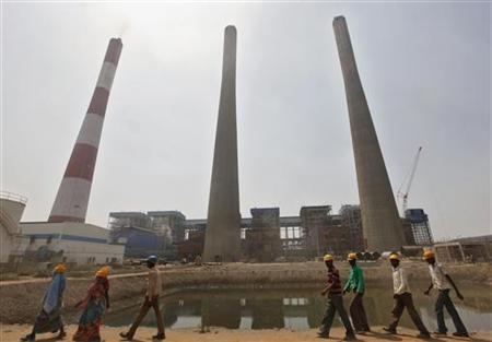 Workers walk inside the Jindal Power and Steel Ltd. complex at Nisha village in Orissa March 27, 2012. REUTERS/Rupak De Chowdhuri/Files