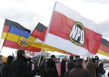 Party members of the far-right National Democratic Party (NPD) attend a protest rally in front of a hotel where German state ministers are holding a conference in Rostock December 5, 2012. REUTERS/Tobias Schwarz