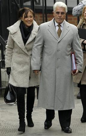 Publicist Max Clifford arrives with wife Jo to give evidence to the Leveson Inquiry into the culture, practices and ethics of the media at the High Court in London February 9, 2012. REUTERS/Luke MacGregor/Files