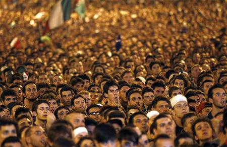 Italian supporters watch their team play against Germany during their Euro 2012 semi-final soccer match, in Rome June 28, 2012. REUTERS/ Giampiero Sposito