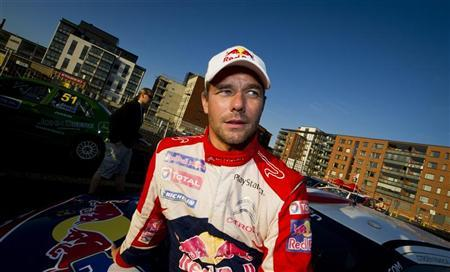 Winner of rally Sebastien Loeb is seen after the FIA World Rally Championship WRC Neste Oil Rally Finland near Jyvaskyla August 4, 2012. REUTERS/Roni Rekomaa/Lehtikuva