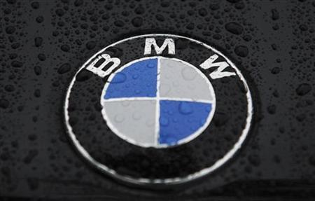 A logo of BMW is pictured on a car before the German luxury carmaker BMW annual shareholders meeting at the company's headquarters in Munich, May 16, 2012. REUTERS/Guido Krzikowski