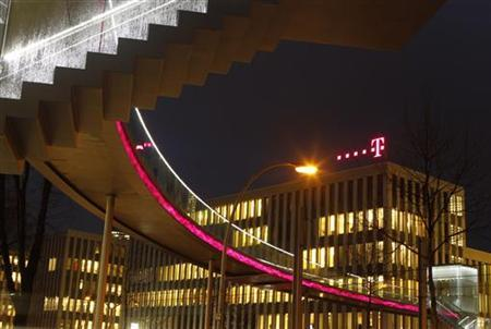 The logo of Deutsche Telekom AG is seen at their headquarters in Bonn December 5, 2012. After keeping up its dividend when all around it were cutting theirs, Deutsche Telekom is expected to join the throng of European telcos diverting cash from shareholder payouts to capital investment. REUTERS/Ina Fassbender (GERMANY - Tags: BUSINESS TELECOMS)
