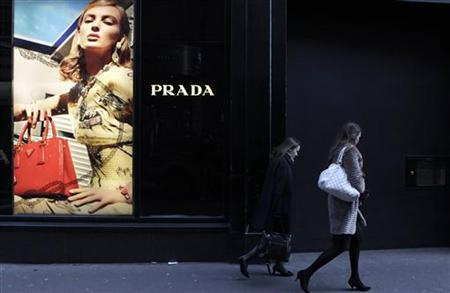 People walk past a Prada store on Grafton Street in central Dublin, January 26, 2012. REUTERS/Cathal McNaughton