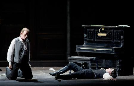 Baritone Tomas Tomasson (L) of Iceland and German soprano Evelyn Herlitzius perform during a rehearsal at the La Scala opera theatre in Milan in this December 4, 2012 handout photo. REUTERS/Monika Rittershaus/La Scala press office/Handout