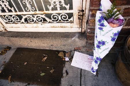 Flowers rest on the ground outside of the home of Ki-Suck Han in New York, December 6, 2012. REUTERS/Lucas Jackson