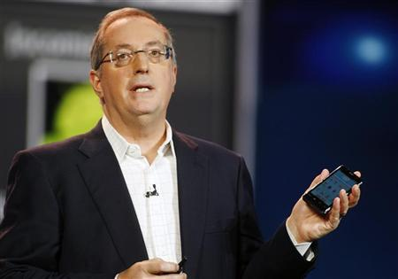 Paul Otellini, president and CEO of Intel Corporation, holds an Intel smartphone reference design as he gives a keynote address during the 2012 International Consumer Electronics Show (CES) in Las Vegas, Nevada, January 10, 2012. REUTERS/Steve Marcus