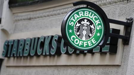 A sign is seen outside a Starbucks Coffee shop in central London December 3, 2012. REUTERS/Andrew Winning