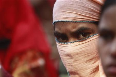 A garment worker takes part in a rally protesting against the deaths of colleagues, after a devastating fire in a garment factory, in Dhaka November 27, 2012. REUTERS/Andrew Biraj