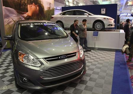 The 2013 Ford C-Max Energi (L) and 2013 Ford Fusion Energi hybrids are displayed in the lobby of the Las Vegas Convention Center during the 2012 International Consumer Electronics Show (CES) in Las Vegas, Nevada January 11, 2012. REUTERS/Steve Marcus
