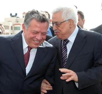Palestinian President Mahmoud Abbas (R) speaks with Jordan's King Abdullah upon his arrival in the West Bank city of Ramallah December 6, 2012. REUTERS/Yousef Allan/Royal Palace/Handout